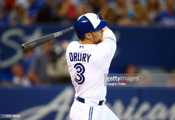 Brandon Drury of the Toronto Blue Jays hits a 2 run home run in the sixth inning during a MLB game against the Boston Red Sox at Rogers Centre on...