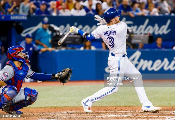 Brandon Drury of the Toronto Blue Jays hits a grand slam against the Texas Rangers in the fourth inning during their MLB game at Rogers Centre on...