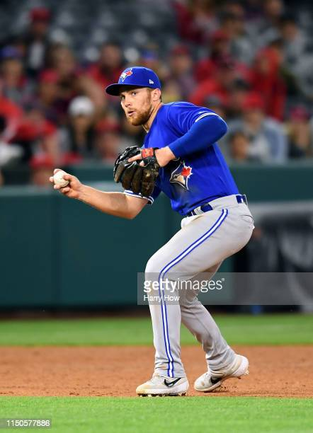 Brandon Drury of the Toronto Blue Jays makes a bare handed play before his throw to first for an out of Luis Rengifo of the Los Angeles Angels during...