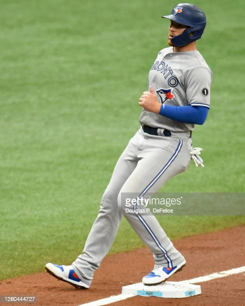 Brandon Drury of the Toronto Blue Jays reaches third base on a wild pitch during the second inning against the Tampa Bay Rays at Tropicana Field on...