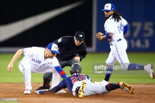 Brandon Drury of the Toronto Blue Jays tags out Byron Buxton of the Minnesota Twins as he attempts to steal second base in the second inning during a...