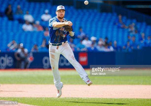 Brandon Drury of the Toronto Blue Jays throws out a runner against the Seattle Mariners in the eighth inning during their MLB game at the Rogers...