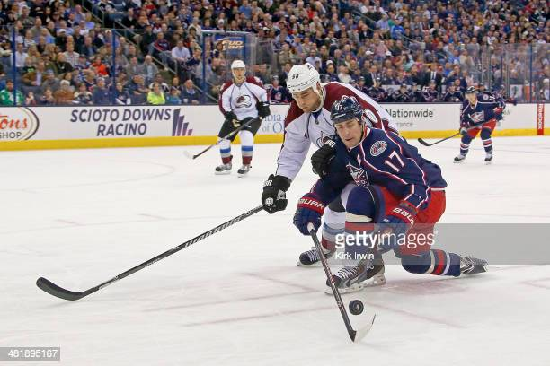 Brandon Dubinsky of the Columbus Blue Jackets and Ryan O'Reilly of the Colorado Avalanche battle for control of the puck during the second period on...