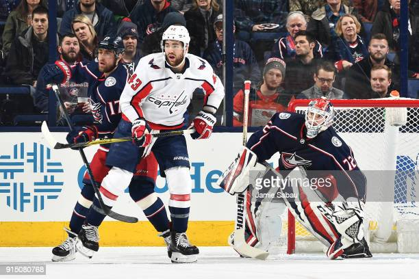 Brandon Dubinsky of the Columbus Blue Jackets and Tom Wilson of the Washington Capitals battle for position as goaltender Sergei Bobrovsky of the...