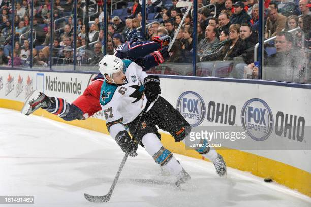 Brandon Dubinsky of the Columbus Blue Jackets and Tommy Wingels of the San Jose Sharks chase after a loose puck during the second period on February...