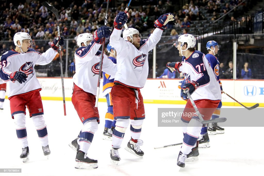 Brandon Dubinsky #17 of the Columbus Blue Jackets (middle) celebrates teammates after after scoring a goal against the New York Islanders in the third period during their game at Barclays Center on February 13, 2018 in the Brooklyn borough of New York City.