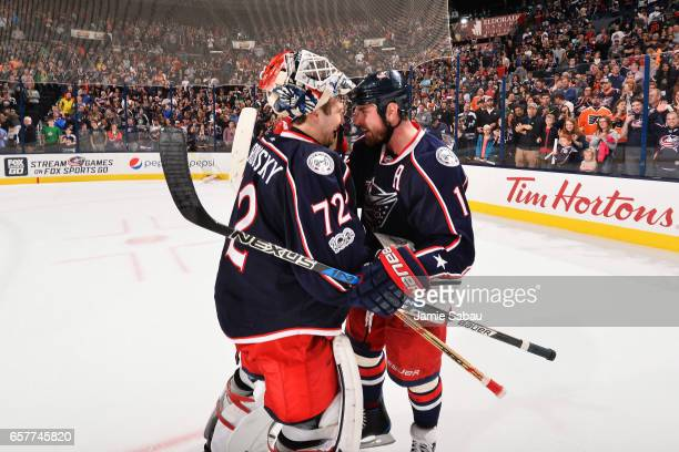 Brandon Dubinsky of the Columbus Blue Jackets congratulates goaltender Sergei Bobrovsky of the Columbus Blue Jackets on shutting out the Philadelphia...