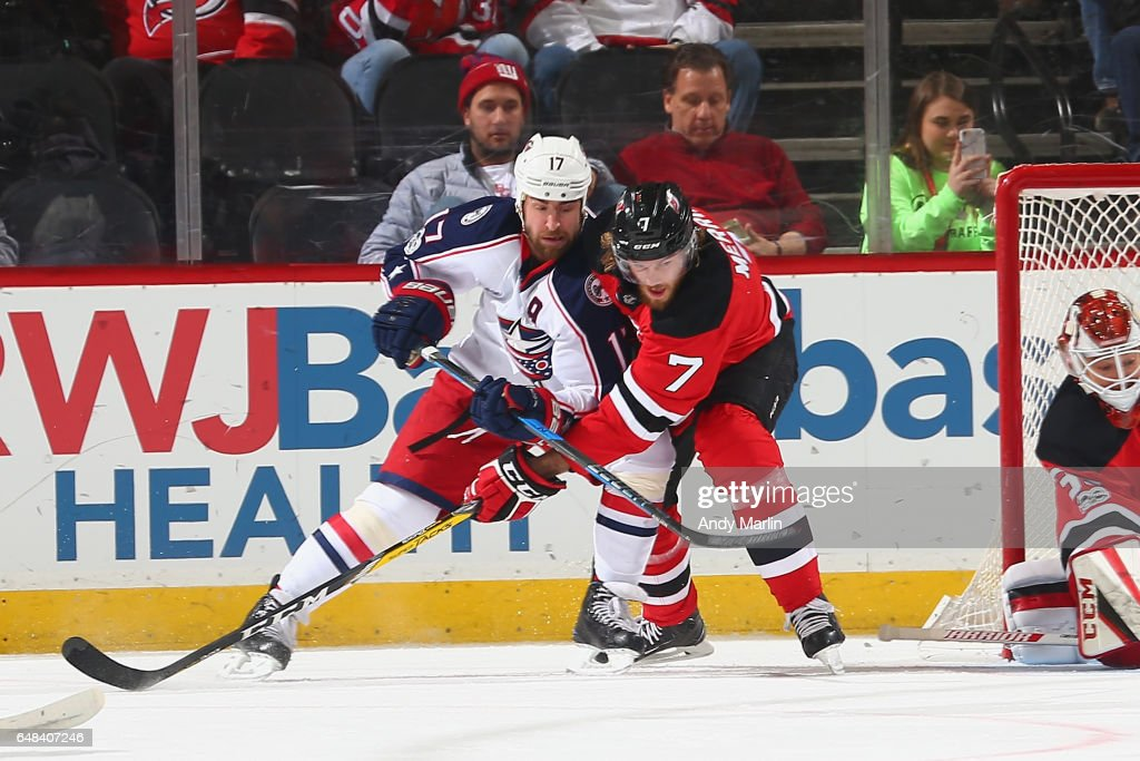 Brandon Dubinsky #17 of the Columbus Blue Jackets Jon Merrill #7 of the New Jersey Devils battle for position during the game at Prudential Center on March 5, 2017 in Newark, New Jersey.