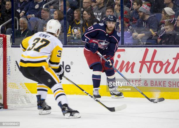 Brandon Dubinsky of the Columbus Blue Jackets looks to clear the puck during second period of the game between the Columbus Blue Jackets and the...