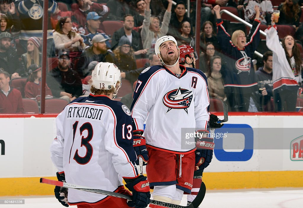 Brandon Dubinsky #17 of the Columbus Blue Jackets reacts to his open net goal against the Arizona Coyotes as Cam Atkinson #13 skates in during the third period at Gila River Arena on December 17, 2015 in Glendale, Arizona.