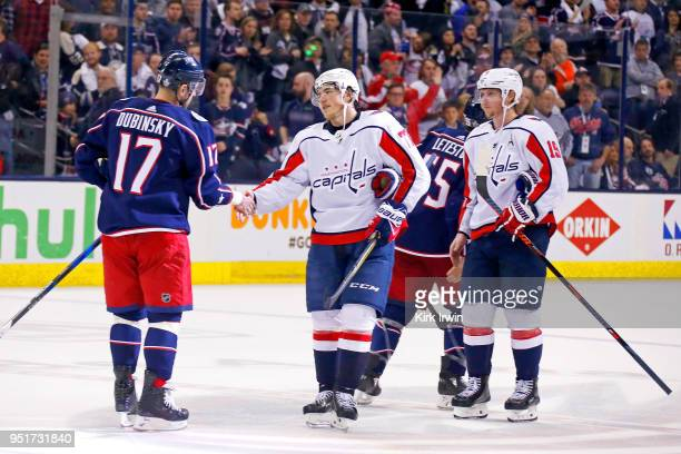 Brandon Dubinsky of the Columbus Blue Jackets shakes hands with TJ Oshie of the Washington Capitals after the end of Game Six of the Eastern...