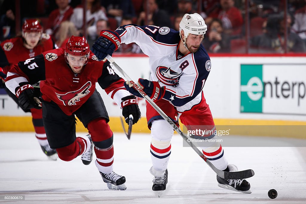 Brandon Dubinsky #17 of the Columbus Blue Jackets skates with the puck ahead of Stefan Elliott #45 of the Arizona Coyotes during the NHL game at Gila River Arena on December 17, 2015 in Glendale, Arizona. The Blue Jackets defeated the Coyotes 7-5.