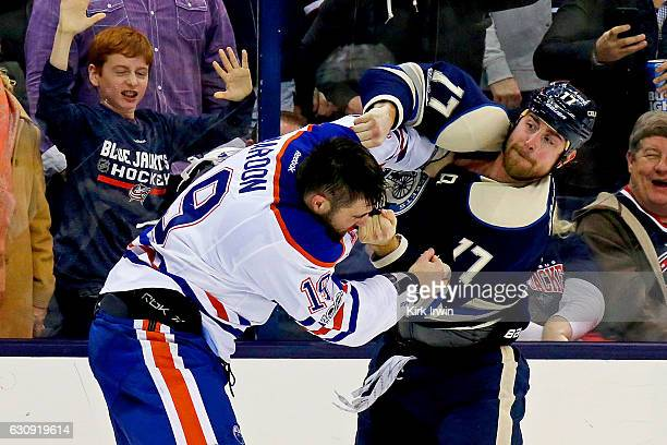 Brandon Dubinsky of the Columbus Blue Jackets throws a punch while fighting with Patrick Maroon of the Edmonton Oilers during the second period on...
