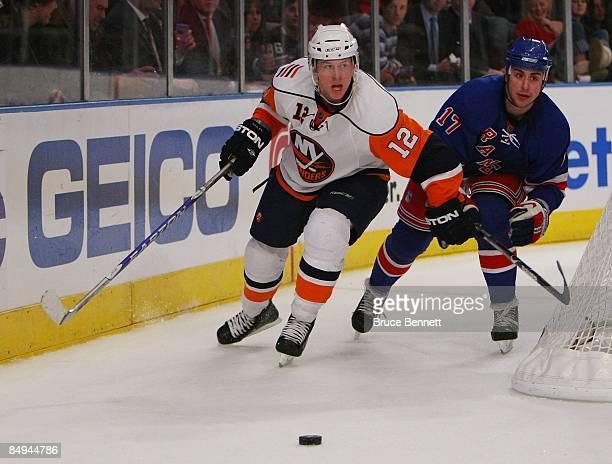Brandon Dubinsky of the New York Rangers checks Josh Bailey of the New York Islanders on February 18 2009 at Madison Square Garden in New York City