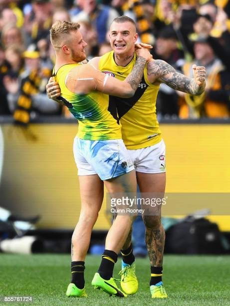Brandon Ellis and Dustin Martin of the Tigers celebrate winning the 2017 AFL Grand Final match between the Adelaide Crows and the Richmond Tigers at...