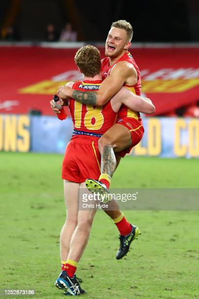 Brandon Ellis and Matthew Rowell of the Suns celebrate winning the round 4 AFL match between the Gold Coast Suns and Fremantle Dockers at Metricon...