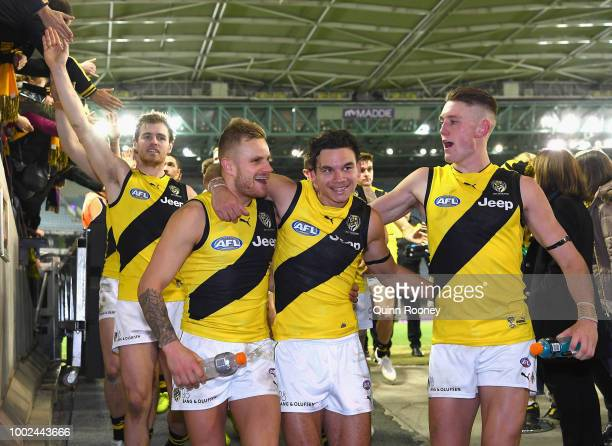 Brandon Ellis Daniel Rioli and Callum Moore of the Tigers celebrate winning the round 18 AFL match between the St Kilda Saints and the Richmond...