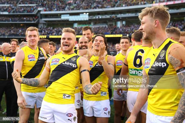 Brandon Ellis of the Tigers and team mates celebrate winning the 2017 AFL Grand Final match between the Adelaide Crows and the Richmond Tigers at...