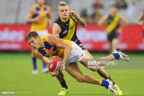 Brandon Ellis of the Tigers tackles Brad Sheppard of the Eagles during the round three AFL match between the Richmond Tigers and the West Coast...