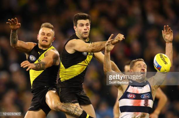 Brandon Ellis of the Tigers Trent Cotchin of the Tigers and Joel Selwood of the Cats compete for the ball during the round 20 AFL match between the...