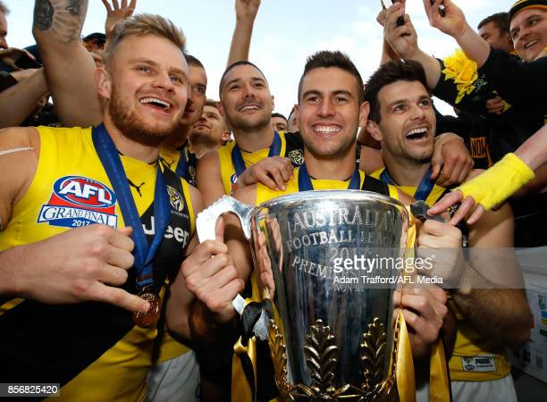 Brandon Ellis Shaun Grigg Jack Graham and Trent Cotchin of the Tigers come off the field with the premiership cup during the 2017 Toyota AFL Grand...