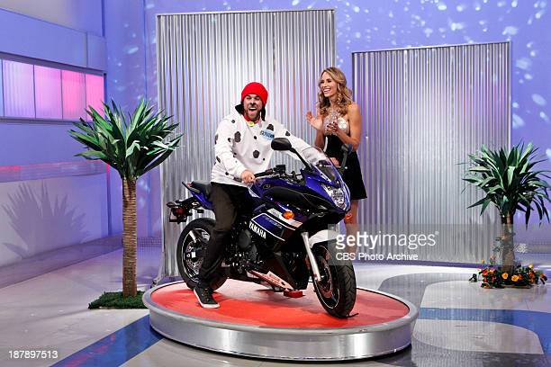 Brandon Elmore left of Huntington Beach CA hops on his brand new motorcycle as model Danielle Demski claps in approval on a special Twitter episode...