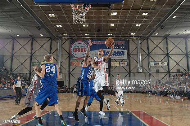 Brandon Fields of the Grand Rapids Drive drives to the basket past Drew Gordon of the Delaware 87ers during the NBA D-League game on January 31, 2015...