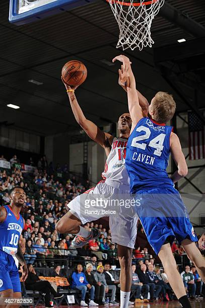 Brandon Fields of the Grand Rapids Drive goes to the basket around Joonas Caven of the Delaware 87ers during the NBA D-League game on January 31,...