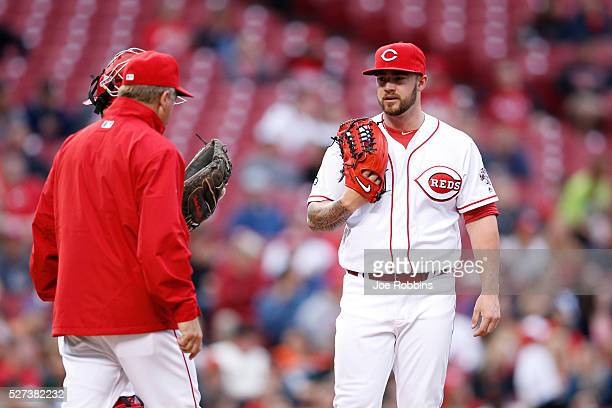 Brandon Finnegan of the Cincinnati Reds looks on after giving up three runs in the second inning of the game against the San Francisco Giants at...
