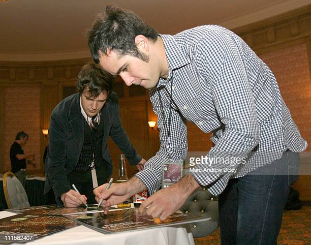 Brandon Flowers and Ronnie Vannucci of The Killers sign autographs backstage before MTV2's $2 Bill Concert Series at The Roxy in Boston Massachusetts...