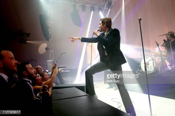 Brandon Flowers of The Killers performs onstage during the 27th annual Elton John AIDS Foundation Academy Awards Viewing Party sponsored by IMDb and...