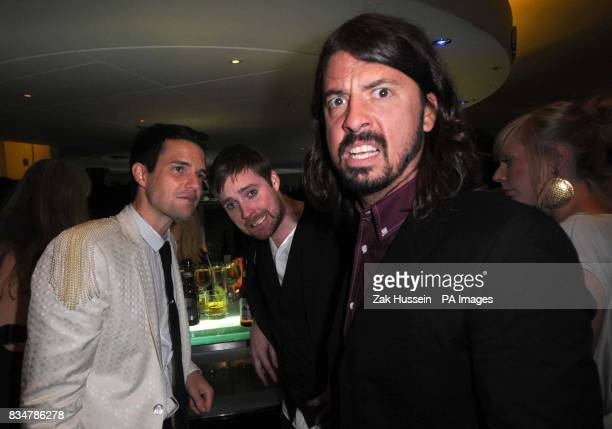 Brandon Flowers of the Killers Ricky Wilson of the Kaiser Chiefs and Dave Grohl of the Foo Fighters pictured during the GQ Men Of The Year Awards...