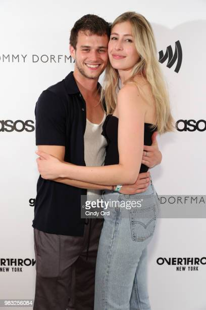 Brandon Flynn and Caitlin Woods attend the NYC Pride Party benefiting GLAAD hosted by Tommy Dorfman and Overthrow Boxing at Overthrow Underground...