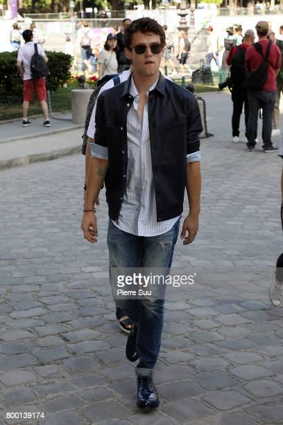 Brandon Flynn arrives at the Cerruti Menswear Spring/Summer 2018 show as part of Paris Fashion Week on June 23 2017 in Paris France