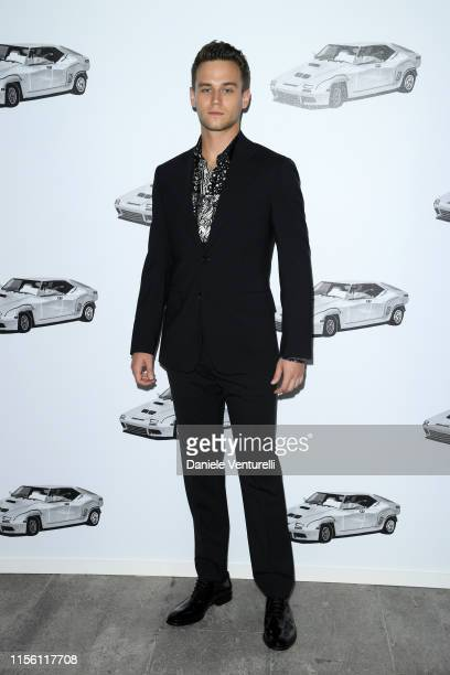 Brandon Flynn attends the Versace fashion show during the Milan Men's Fashion Week Spring/Summer 2020 on June 15, 2019 in Milan, Italy.