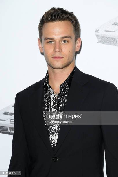 Brandon Flynn attends the Versace fashion show during the Milan Men's Fashion Week Spring/Summer 2020 on June 15 2019 in Milan Italy
