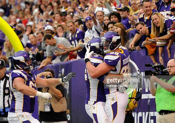 Brandon Fusco Matt Kalil and Kyle Rudolph of the Minnesota Vikings celebrate a touchdown by Rudolph during the fourth quarter of the game against the...