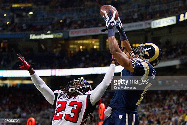 Brandon Gibson of the St Louis Rams catches a touchdown pass against Dunta Robinson of the Atlanta Falcons at the Edward Jones Dome on November 21...