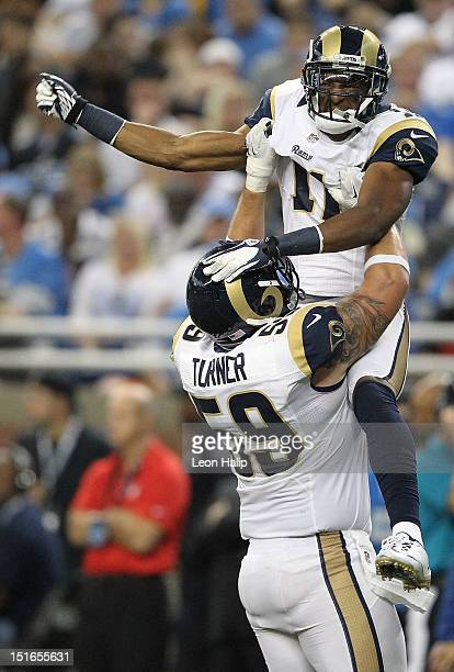 Brandon Gibson of the St Louis Rams scores on a 23 yard pass from Sam Bradford and celebrates with teammate Robert Turner during the game at Ford...