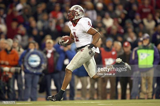 Brandon Gibson of the Washington State Cougars carries the ball during the 100th Apple Cup Game against the Washington Huskies at Husky Stadium on...