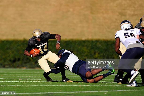 Brandon Goodson quarterback Wofford College Terriers is sacked by Anthony Ellis defensive lineman Charleston Southern University Buccaneers in the...