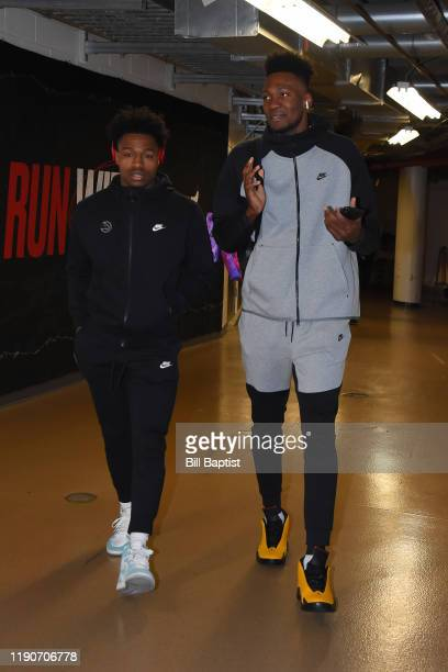 Brandon Goodwin and Bruno Fernando of the Atlanta Hawks arrive to the game against the Chicago Bulls on December 28 2019 at the United Center in...