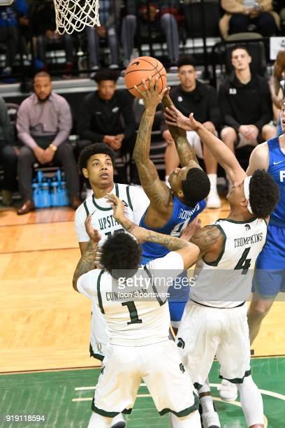 Brandon Goodwin guard Florida Gulf Coast University Eagles finds the basket despite being tripleteamed by Mike Cunningham guard Ramel Thompkins...