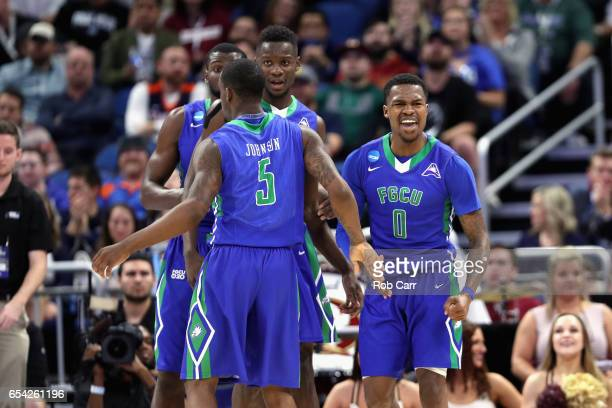 Brandon Goodwin of the Florida Gulf Coast Eagles celebrates with teammates in the first half against the Florida State Seminoles during the first...
