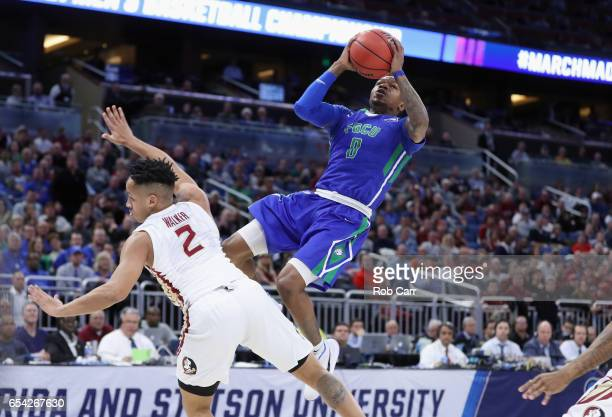 Brandon Goodwin of the Florida Gulf Coast Eagles shoots the ball against CJ Walker of the Florida State Seminoles in the second half during the first...