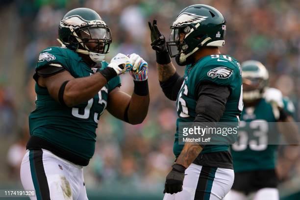 Brandon Graham and Derek Barnett of the Philadelphia Eagles react in the third quarter against the New York Jets at Lincoln Financial Field on...