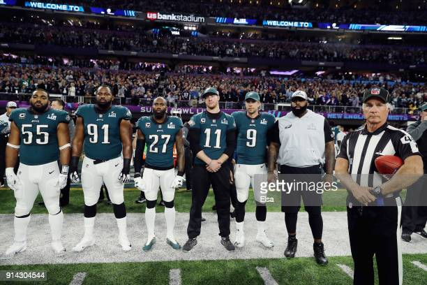 Brandon Graham Fletcher Cox Malcolm Jenkins Carson Wentz and Nick Foles of the Philadelphia Eagles stand for the national anthem prior to Super Bowl...