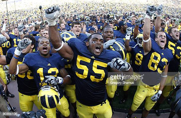 Brandon Graham of the Michigan Wolverines leads his teammates in singing the schools fight song after beating the Western Michigan Broncos 31-7 on...