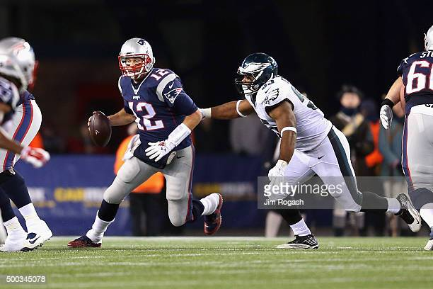 Brandon Graham of the Philadelphia Eagles attempts to tackle Tom Brady of the New England Patriots during the second half at Gillette Stadium on...