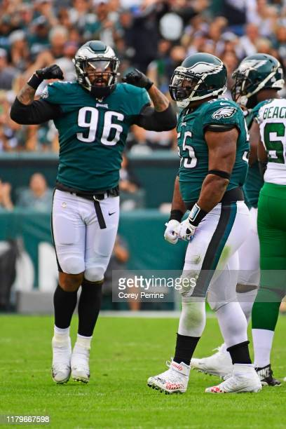 Brandon Graham of the Philadelphia Eagles flexes after a sack as teammate Derek Barnett of the Philadelphia Eagles looks on during the third quarter...
